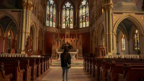 girl in front of church alter